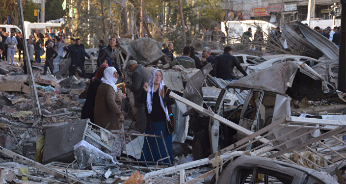 Residents react after a blast in Diyarbakir, Turkey, November 4, 2016.
