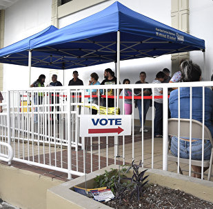 People line up to vote at an early voting polling centre in Miami, Florida on November 3, 2016.