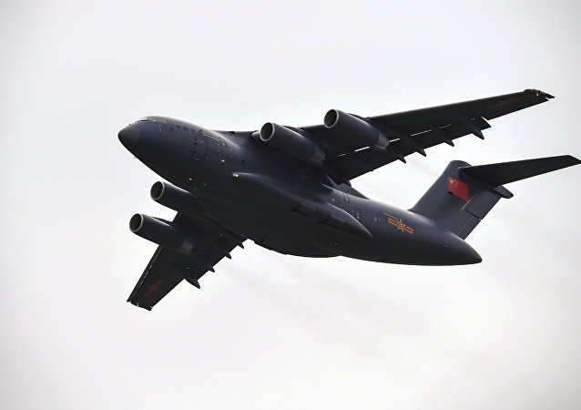 A Xian Y-20 heavy transport aircraft flies past during the Zhuhai Air Show in Zhuhai, southern China's Guangdong province on November 1, 2016.