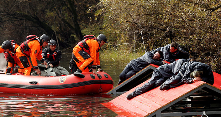 Rescue workers evacuate mock flood victims as part of an international field exercise organised and conducted by NATO's Euro-Atlantic Disaster Response Coordination Centre (EADRCC) in Podgorica, Montenegro