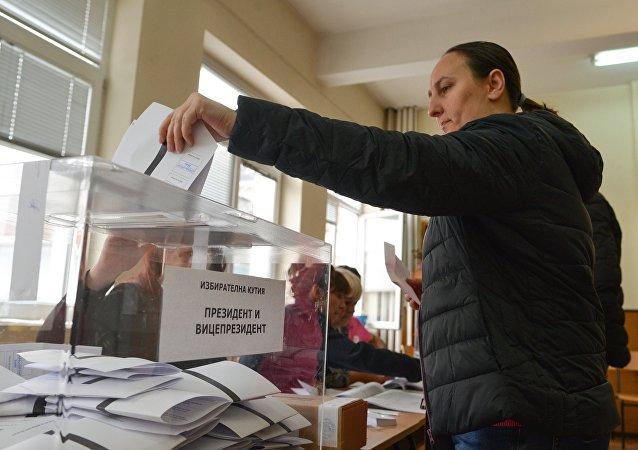 A voter casts her vote at a polling station in Sofia during Bulgarian presidential elections and a national referendum on the electoral code