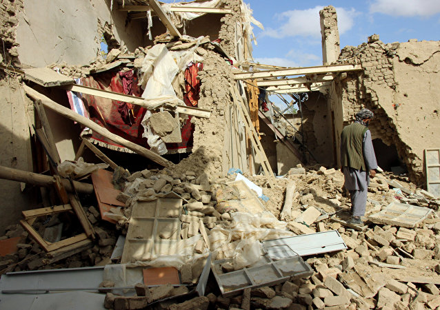 An Afghan man inspects a house destroyed during an air strike called in to protect Afghan and U.S. forces during a raid on suspected Taliban militants, in Kunduz, Afghanistan. file photo