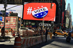 An electronic billboard displays a vote hashtag at Times Square in New York, U.S., November 7, 2016