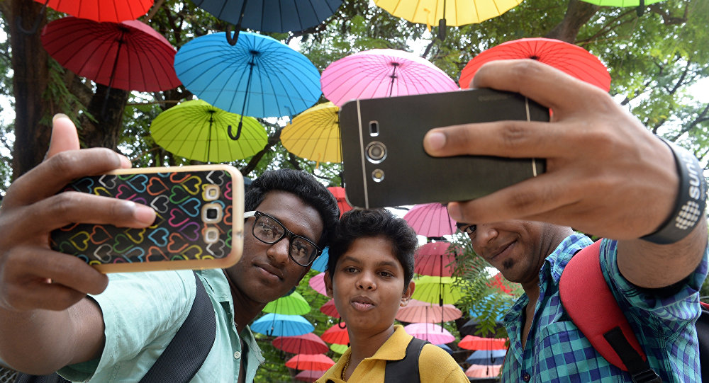 In this photograph taken on June 16, 2015, Indian students click a selfie at a designated 'selfie point' in Mumbai