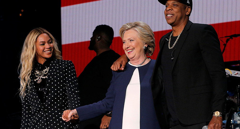 U.S. Democratic presidential nominee Hillary Clinton joins Jay Z and Beyonce onstage at a campaign concert in Cleveland, Ohio, U.S. November 4, 2016.