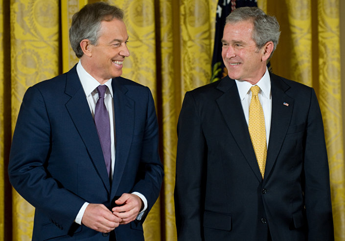 Former US President George W. Bush smiles alongside former British Prime Minister Tony Blair.