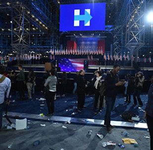 Supporters of Democratic presidential nominee Hillary Clinton walk through convention center at the end of election night at the Jacob K. Javits Convention Center in New York on November 8, 2016