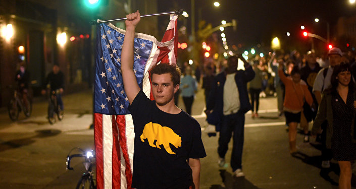 Protesters against president-elect Donald Trump march through Oakland, California, U.S., November 9, 2016