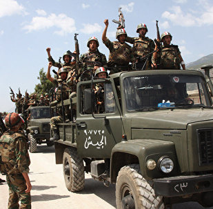 Syrian army soldiers standing on their military trucks chanting slogans in support of Syrian President Bashar Assad, as they enter a village near the town of Jisr al-Shughour, north of Damascus, Syria (File)