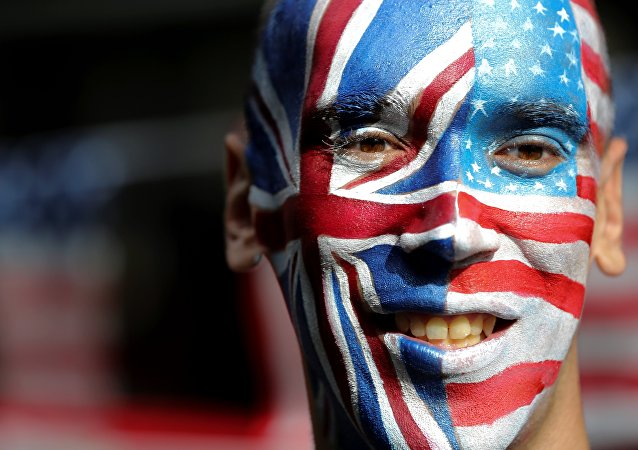 An activist with a face painted with the British Union Flag (L) and the US flag (R) poses in front of a Stop Trump battle bus in London on September 21, 2016 in a campaign run by campaign group Avaaz to mobilise US expatriots in the UK to register to vote in the US presidential election. Voters are set to go to the polls to elect the 45th president of the US on November 8, 2016.