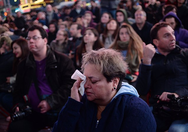 People on Times Square in New York follow the preliminary results of the US election