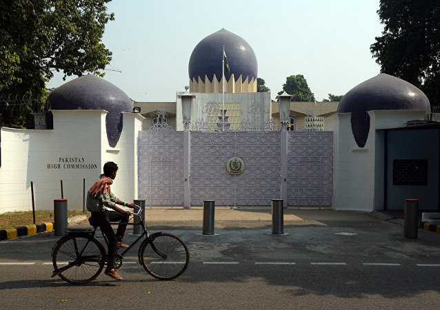 An Indian cyclist rides past the entrance to the Pakistan High Commission in New Delhi on October 27, 2016