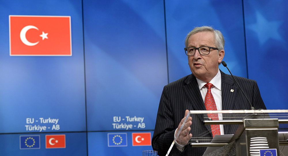 European Union Commission President Jean-Claude Juncker talks to the media at the end of an European Union Summit held at the EU Council building in Brussels, Friday March 18, 2016.