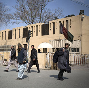 Afghans walk by the Serena hotel in downtown Kabul, Afghanistan, Friday, March 21, 2014