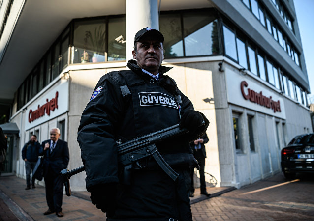A security agent stands guard in front of Cumhuriyet newspaper headquarter (File)