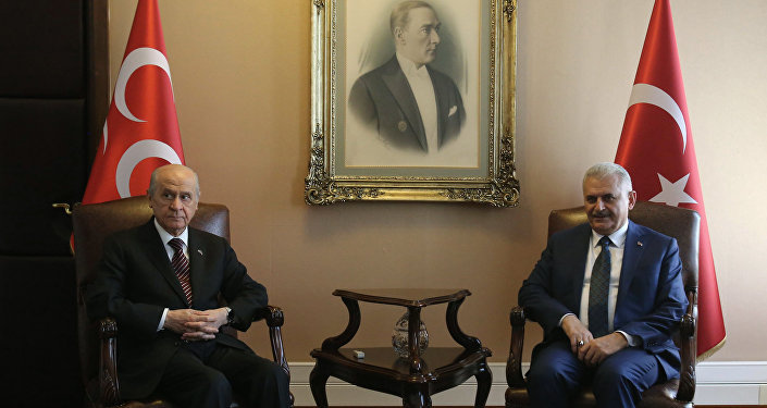 Turkish Prime Minister Binali Yildirim (R) and Nationalist Movement Party (MHP) Devlet Bahceli (L) pose for a photograph during their meeting at Turkish Grand National Assembly (TBMM) in Ankara, on August 01, 2016