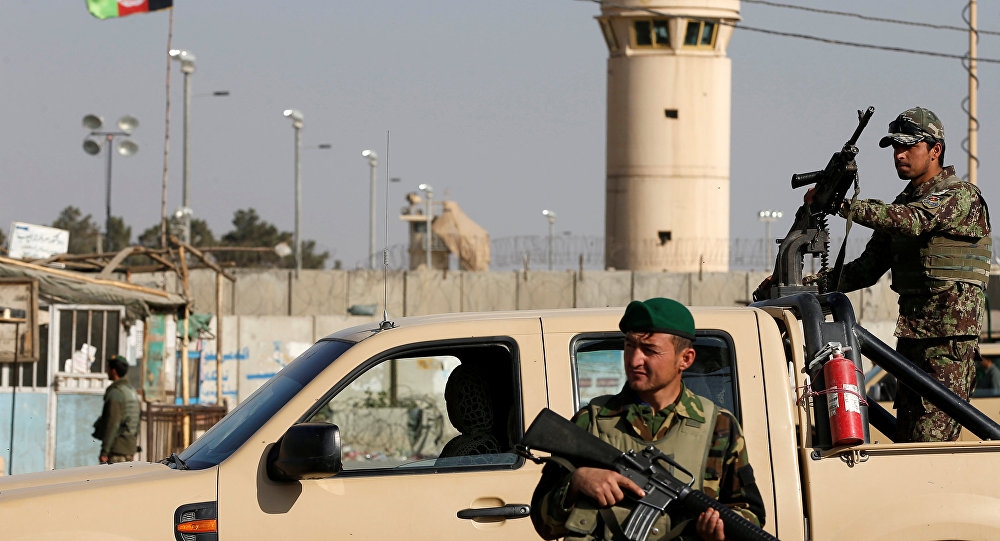 (File) Afghan National Army (ANA) soldiers keep watch outside the Bagram Airfield entrance gate, after an explosion at the NATO air base, north of Kabul, Afghanistan November 12, 2016.