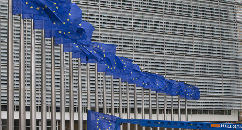 Workers adjust the EU flags in front of EU headquarters in Brussels. (File)