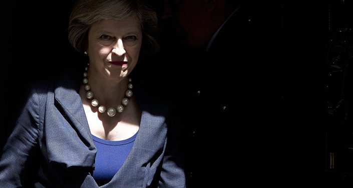 British Prime Minister Theresa May exits 10 Downing Street in London.