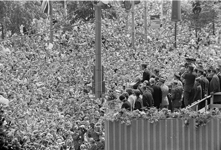 A cheering crowd, estimated by police at more than a quarter of a million, fills the area beneath the podium at West Berlin's City Hall, where US President John F. Kennedy stands. His address to the City Hall crowd was one of the highlights of his June 26, 1963 visit to West Berlin, where he received one of the greatest receptions of his career.