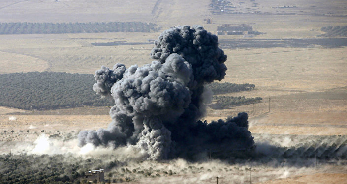 Smoke rises at Islamic State militants' positions in the town of Naweran, near Mosul, Iraq (File)