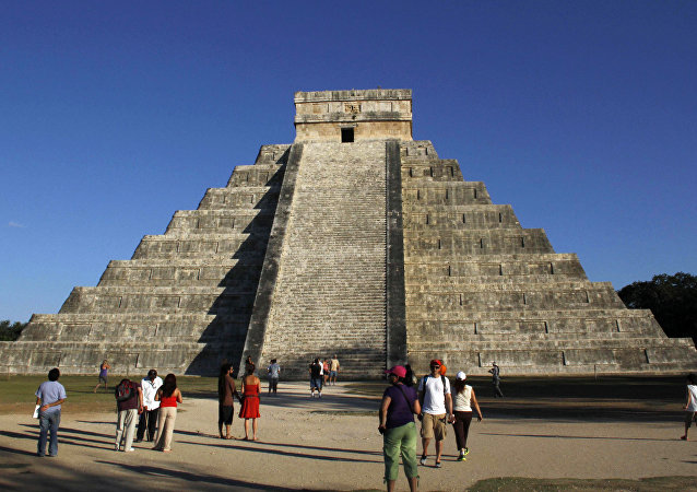 People gather in front of the Kukulkan Pyramid in Chichen Itza, Mexico, Thursday, Dec. 20, 2012