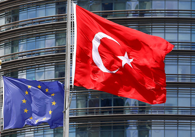 A European Union (L) and Turkish flag fly outside a hotel in Istanbul, Turkey.