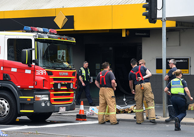 Emergency service workers are seen at a branch of the Commonwealth Bank after a fire injured customers in Melbourne, Australia November 18, 2016