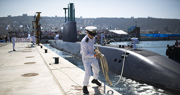 An Israeli naval officer holds the mooring rope of the INS Tanin, a Dolphin AIP class submarine, as it docks at a naval base in the northern city of Haifa, after its arrival in Israel (File)