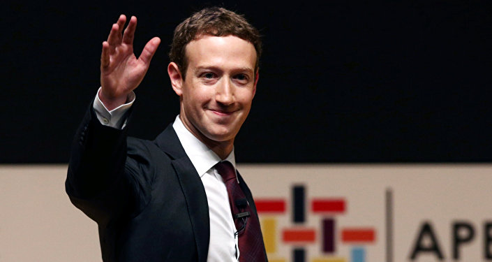 Facebook founder Mark Zuckerberg waves to the audience during a meeting of the APEC (Asia-Pacific Economic Cooperation) Ceo Summit in Lima, Peru, November 19, 2016
