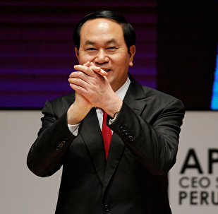 Vietnam's President Tran Dai Quang gestures during a meeting of the APEC (Asia-Pacific Economic Cooperation) CEO Summit in Lima, Peru, November 19, 2016.