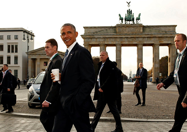 U.S. President Barack Obama walks past the Brandenburg Gate during his visit to Berlin, Germany November 17, 2016.