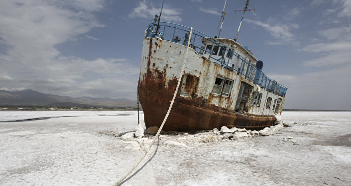 FILE - In this Friday, April 29, 2011 file photo, an abandoned ship is stuck in the solidified salts of the Oroumieh Lake, Iran.