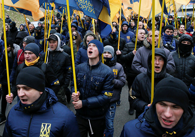 Activists of the National Corps political party attend a march demanding to complete the investigation into the killings during the Ukrainian pro-European Union (EU) mass protests in 2014, on the Day of Dignity and Freedom in central Kiev, Ukraine