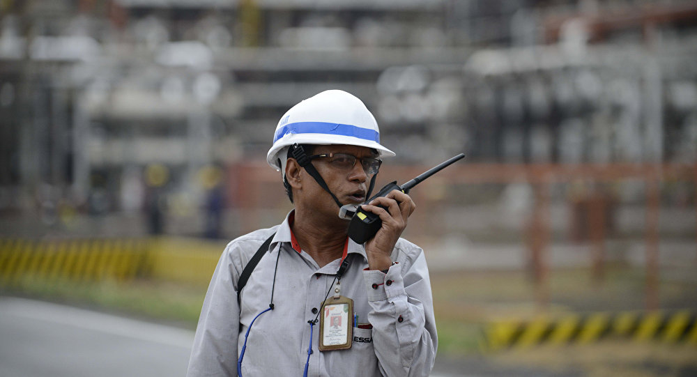 Worker talking on a two-way radio at an Indian oil refinery belonging to Essar Oil at Vadinar, some 380km from Ahmedabad.