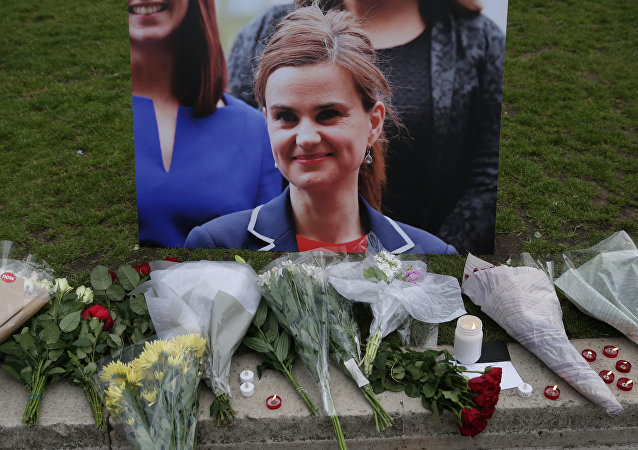 Floral tributes and candles placed by a picture of slain Labour MP Jo Cox at a vigil in Parliament square in London. (File)