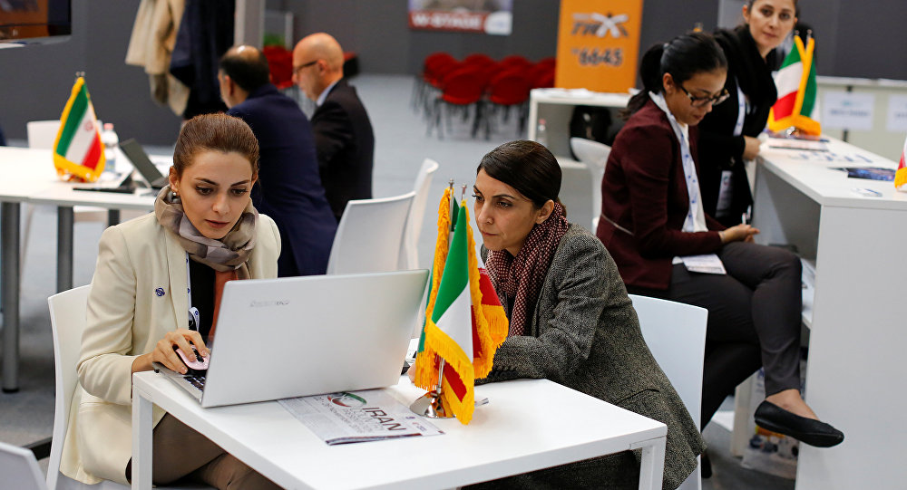 Iranian exhibitors sit in a pavilion during the opening of the fair Iran country presentation in Rome, Italy November 22, 2016