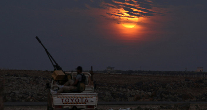 A Free Syrian army fighter sits on a pick-up truck mounted with a weapon, as the supermoon partly covered by clouds is seen in the background, in the west of the rebel-held town of Dael, in Deraa Governorate, Syria November 14, 2016