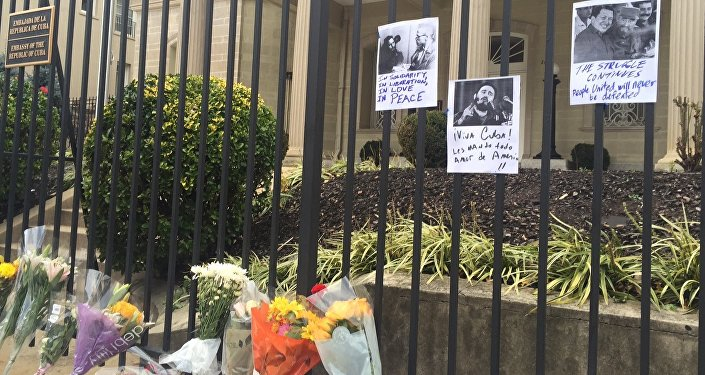 Dozens of people are bringing flowers to the Cuban embassy in Washington on Saturday to honor the memory of former Cuban President Fidel Castro, who passed away on Friday night