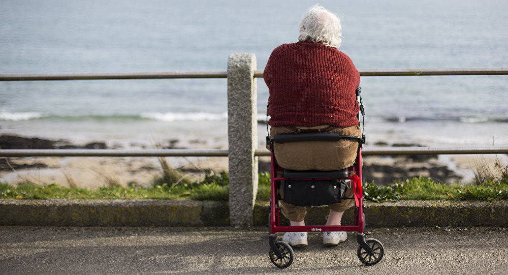 An elderly man looks out to sea in Falmouth, south west England on March 10, 2015