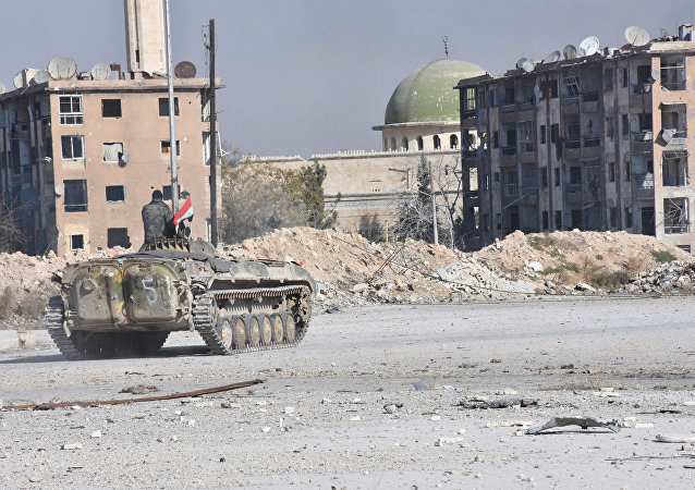 A Syrian government soldier rides a military vehicle near a mosque, after taking control of Aleppo's Al-Haidariya neighbourhood, Syria. (File)