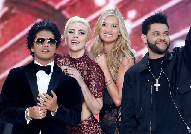 Musicians Bruno Mars (L), Lady Gaga (2ndL) and The Weeknd (R) appear with model Elsa Hosk at the end of the 2016 Victoria's Secret Fashion Show at the Grand Palais in Paris, France, November 30, 2016 (for illustration purposes only)