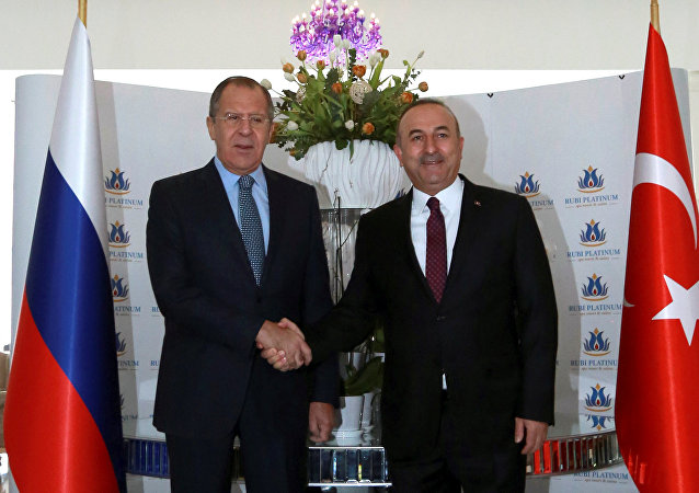 Russian Foreign Minister Sergei Lavrov shakes hands with his Turkish counterpart Mevlut Cavusoglu in Alanya, Turkey, December 1, 2016.