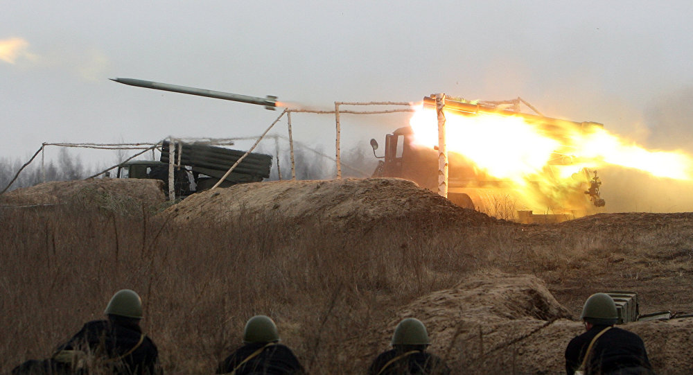 Ukrainian soldiers look at the fire of Soviet Grad missile system (file)