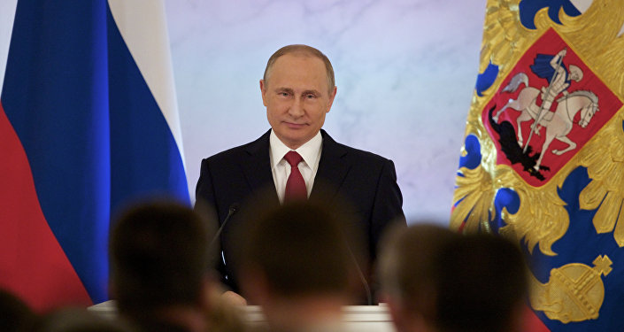 Russian President Vladimir Putin smiles as he gives his annual state of the nation address in the Kremlin in Moscow, Russia, Thursday, Dec. 1, 2016.