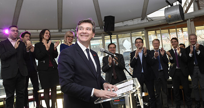Former French Economy Minister Arnaud Montebourg smiles as he gives a speech to officially announce his participation in the left-wing primaries ahead of the 2017 presidential election in Paris