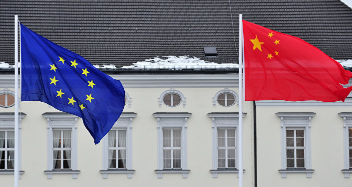 A Chinese (R) and EU flag flutters in front of the presidential palace Schloss Bellevue in Berlin (File)