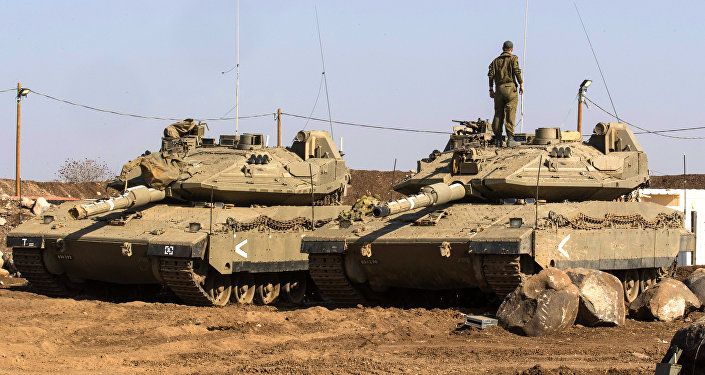 An Israeli soldier stands on top of a Merkava tank near the border with Syria in the Israeli-annexed Golan Heights, on November 28, 2016