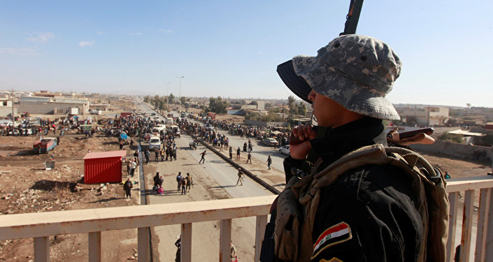 A member of Iraqi security forces stands guard during an operation against Daesh militants in Mosul, Iraq, December 3, 2016