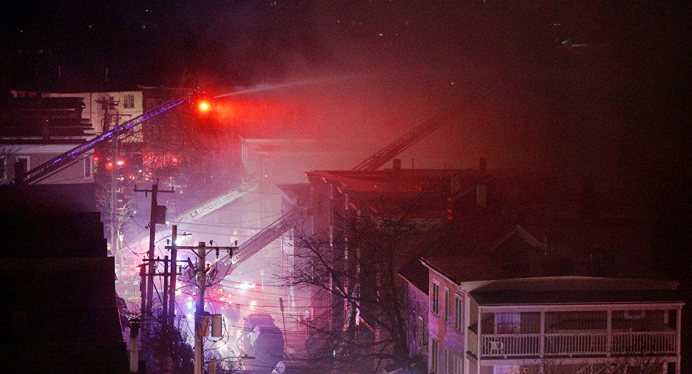 Firefighters battle a multi-alarm fire in a residential area of Cambridge, Massachusetts, U.S., December 3, 2016.